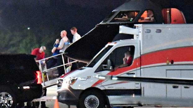 A person believed to be Otto Warmbier is transferred from a medical transport airplane to a waiting ambulance in Ohio, ...