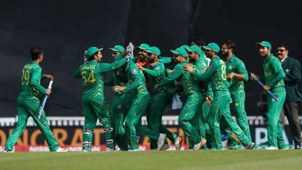Pakistan players celebrate winning the Champions Trophy .