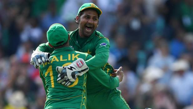 Pakistan captain Sarfraz Ahmed celebrates with Shoaib Malik after winning the Champions Trophy final against India.
