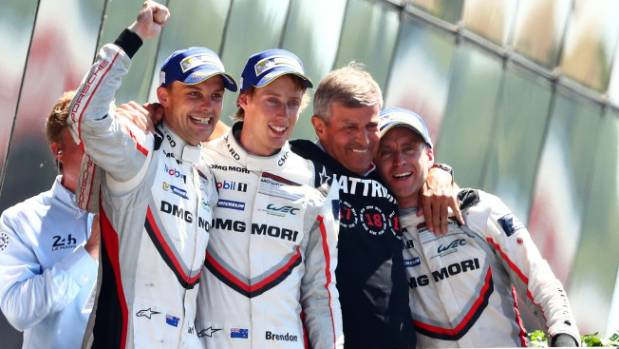 Earl Bamber, Brendon Hartley and Timo Bernhard of the Porsche LMP Team celebrate winning the 24 Hours Le Mans race.