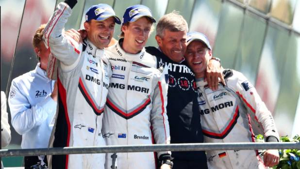 The two Kiwi drivers and their German team-mate celebrate their come-from-behind triumph.