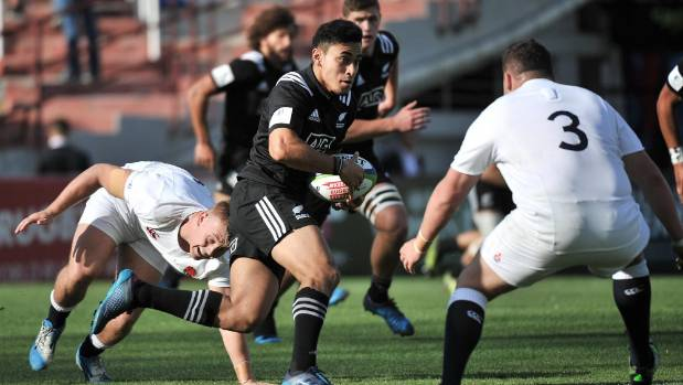New Zealand first five-eighth Stephen Perofeta dances his way through the England defence.