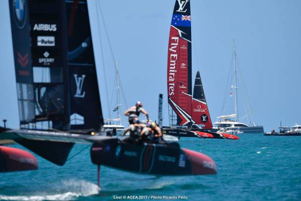 Team USA and Team NZ duel in the start box for race three of the America's Cup final.