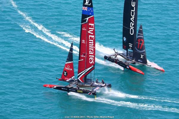 Team NZ powered to a considerable lead over Team USA late in race three of the America's Cup final.