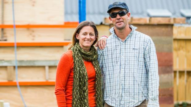 Rochelle and Joel Payne stand in front of their first rammed earth wall - they are practising the technique, building a ...