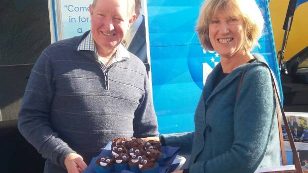 ActionStation volunteer Mary Sullivan delivers MP Nick Smith poo-shaped cupcakes in protest about New Zealand's poor ...