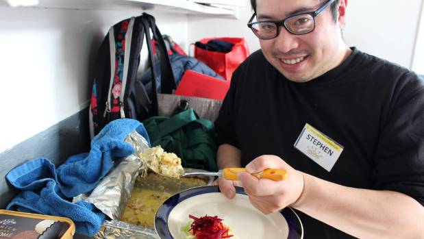 Great Start Taita volunteer Stephen Tse serves up lunch at the Naenae Koha Kitchen. The kitchen provided meals to the ...