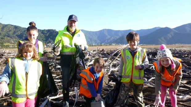 Learning to be tidy Kiwis, from left, Havelock School pupils Abbey, Sakura, Clayton McIntyre from Sanfords, Curtis, Reef ...