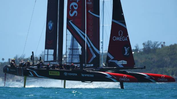 Emirates Team New Zealand tear off the start line ahead of Oracle Team USA during the America's Cup match in Bermuda.