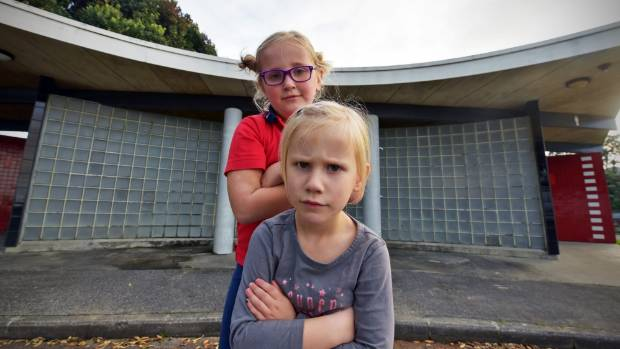 Maddi, 6, and Olivia, 4, had to walk 15 minutes to the closest toilet on Ngapara St, Red Beach.