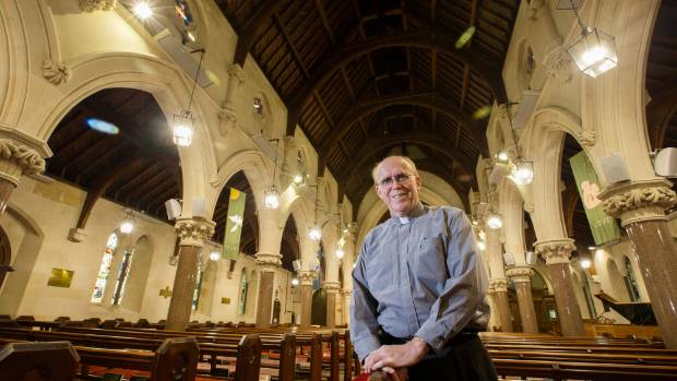 Reverend John Shoaf, of St Mary's Church, Timaru, is pleased with the new lighting system which was dedicated in a ...