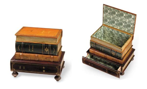 Leather books table with drawer and bunn feet, $1,646 from Scully & Scully.