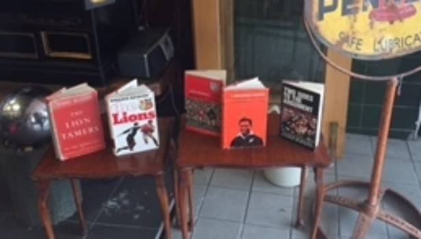 A collection of Lions rugby tour books on display in Rotorua.