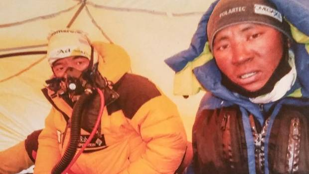 Lama Dawa Sherpa, right, and another guide take shelter in a tent during his latest summit of Everest.