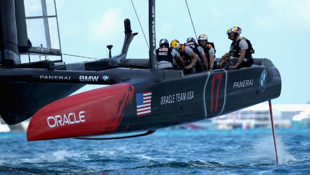 The higher body positions of Jimmy Spithill and his Oracle Team USA crew represent a block to the wind rushing over ...