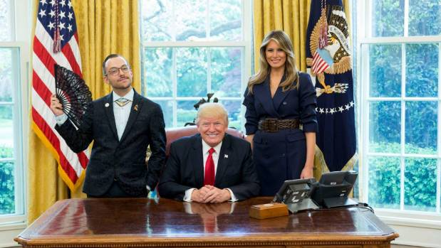 Nikos Giannopoulos poses with President Donald Trump and first lady Melania Trump in the Oval Office in April.