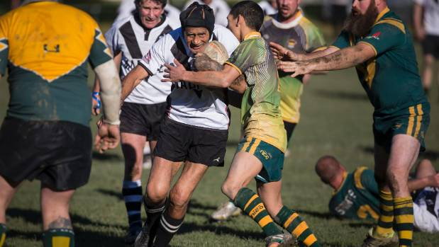 Simon Hone, 72, on the charge for the Addington Magpies against Marist Western Suburbs.