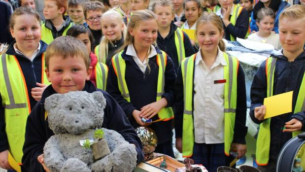 Winton Hospice Shop recycling competition winner Toby King, of Waianiwa School, hold his concrete teddy bear, surrounded ...
