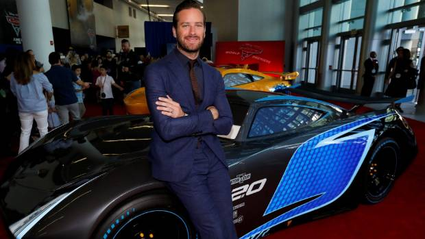 Armie Hammer poses with a life-sized Jackson Storm at the premiere of Cars 3.
