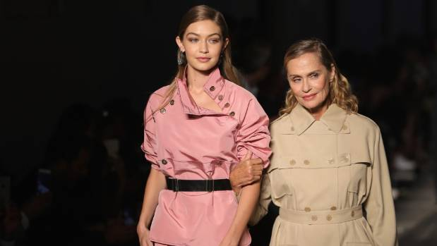 Top model Gigi Hadid (left) and actress Lauren Hutton share the catwalk in Milan last year.