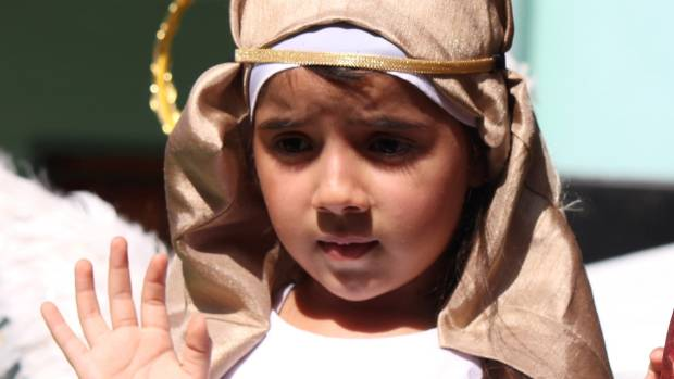 Taking it seriously – a Leon youngster in a Lenten procession.