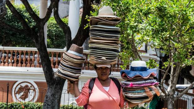 A Nicaraguan hat-seller proving you don't need a large retail space for your stock.