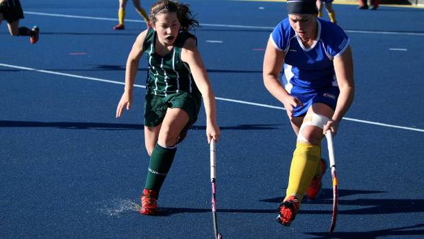 Craighead's Alice Ritchie faces off against Hampstead's Hannah Young in their hockey clash in Ashburton.
