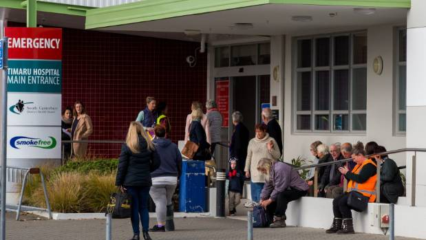 People wait outside Timaru Hospital during the incident.