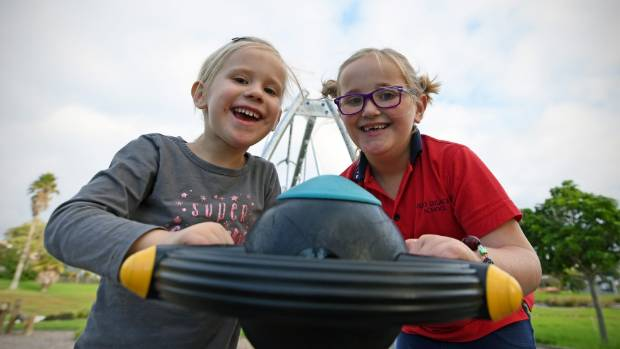 Olivia and Maddi enjoy playing on the Red Beach Park playground.
