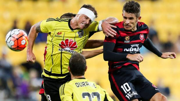 Ben Sigmund (left) makes a challenge typical of the commitment levels he showed when wearing a Wellington Phoenix shirt.