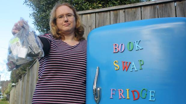 Book Swap Fridge founder Melissa Haylock is disappointed someone swiped an ammunitions tin from behind the fridge. The ...