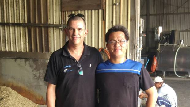 Afimilk professional services manager Yoni Levine and a Vietnamese farm worker.