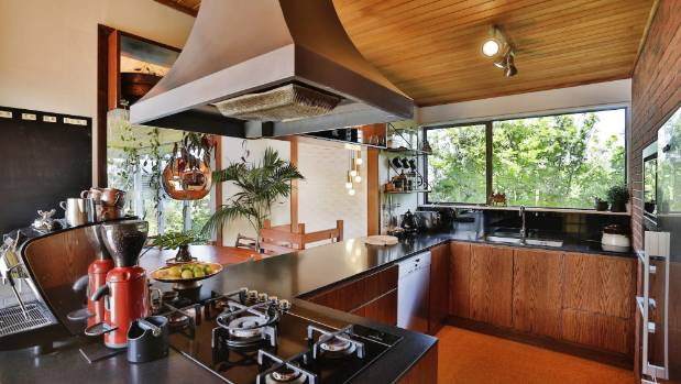 The kitchen was replaced with new cabinetry in keeping with the Mid-century character.