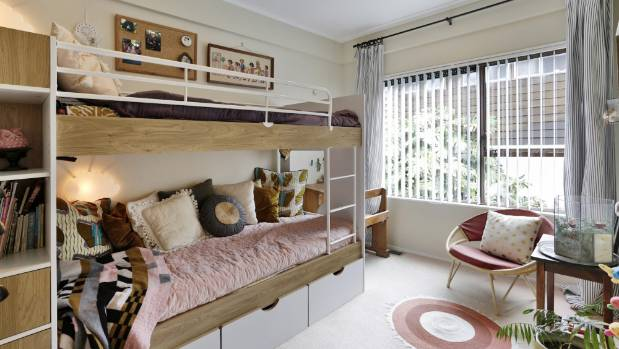 Bunk beds feature in this girl's room.