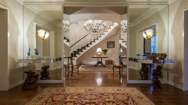 At the entryway of the home, guests are greeted by a mirror-lined formal foyer.