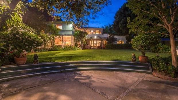 The estate boasts a tennis court, private gardens, a guest house and staff quarters.