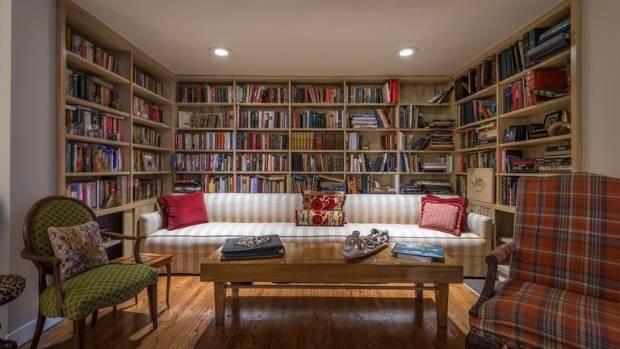 The living room boasts a floor-to-ceiling built-in bookcase.