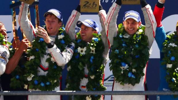 Brendon Hartley, left, Timo Bernhard and Earl Bamber celebrate after winning the 2017 Le Man 24 Hour race.
