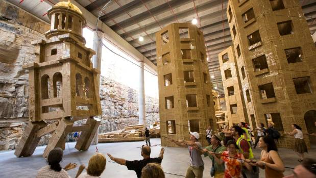 Grossetete enlists the local community to build his fantastical structure out of cardboard boxes.