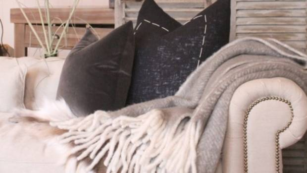 Woolly throws and darker cushions immediately add a cosy feel.