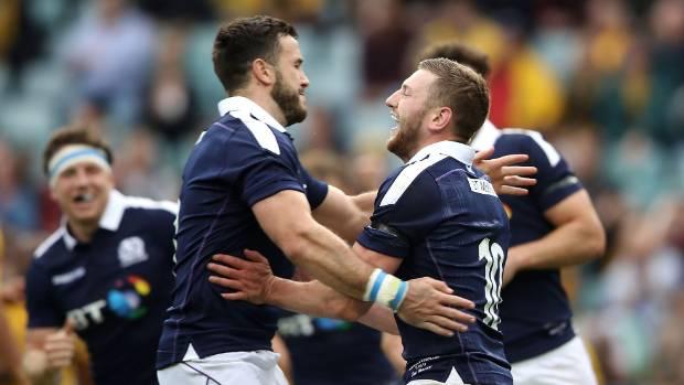 Alex Dunbar and Finn Russell of Scotland celebrate Russell scoring a try.