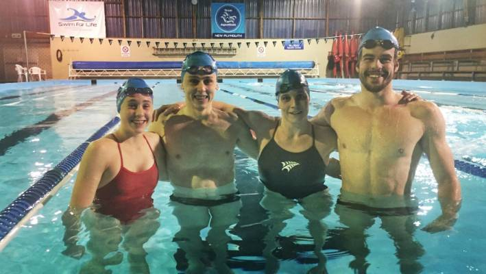 Swimming coach four cocks