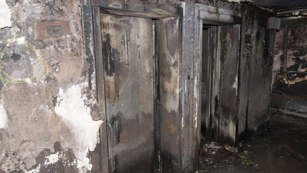 Fire-damaged lifts are seen inside the tower block.