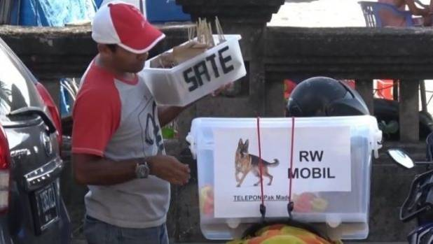 Dog meat is being sold at beaches in Bali on stores carrying an RW sign.
