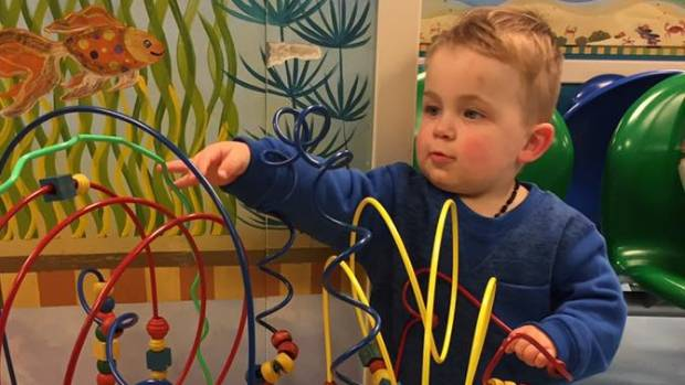 Theo Maddren, 18 months, was with his mum at a supermarket when he was punched in the side of the face.