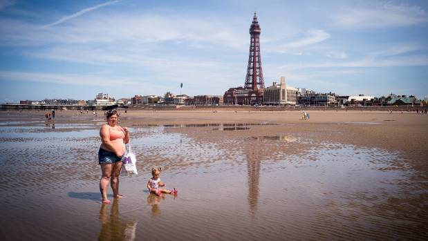 Holidaymakers enjoy the high temperatures on Blackpool beach as the UK has been officially put on heat wave alert.