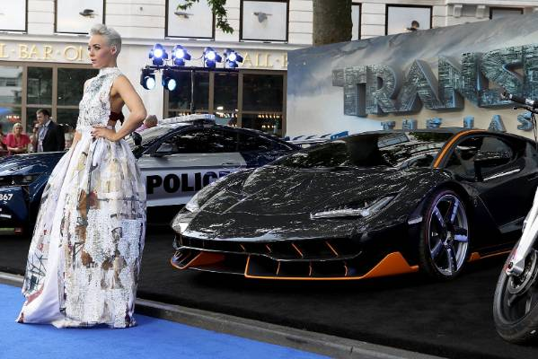 Hatty Keane poses in front of vehicles at the global premiere of Transformers: The Last Knight in London.
