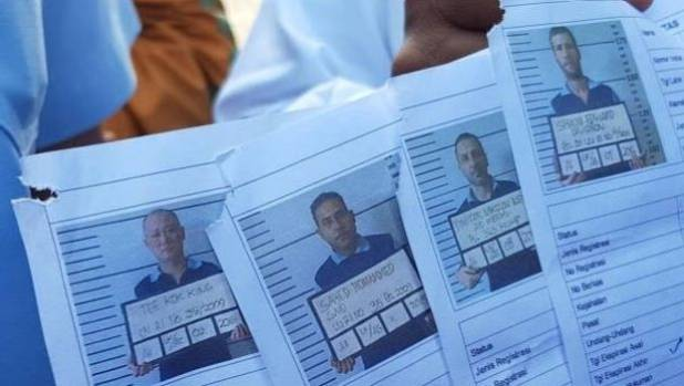 Photos of the missing prisoners, with Australian Shaun Davidson on the far right.