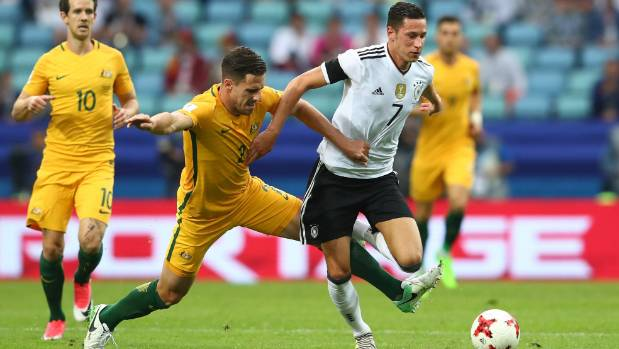 Milos Degenek of Australia and Julian Draxler of Germany battle for possession during th Confederations Cup match in Russia.