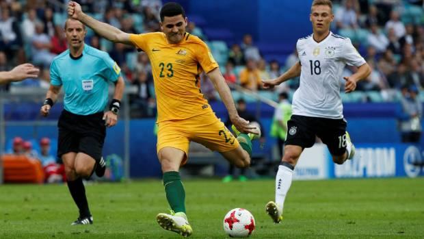 Tom Rogic scores Australia's first goal against Germany.